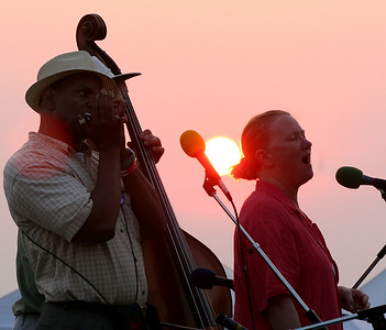 Guy Davis and Holly Near at sunset playing the closing ceremony for the 2006 Clearwater Great Hudson River Revival.