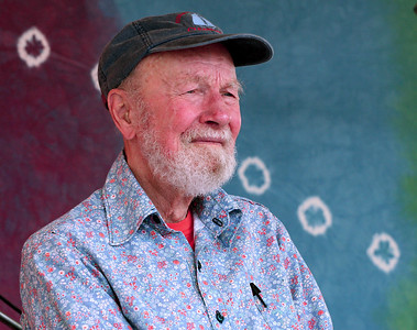 Pete Seeger in a moment of quite reflection moments before going onstage to perform.