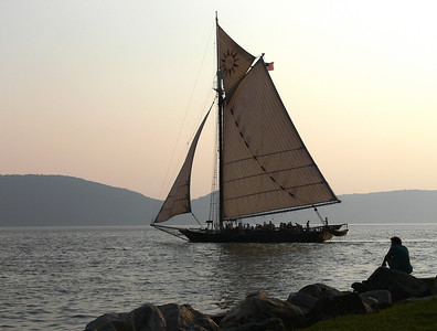 "The Hudson River Sloop Clearwater sailing at sunset with the Hudson Highlands in the background.   This photo can be found in the booklet of Pete Seeger's Grammy Award winning CD, ""Pete Seeger: At 89"" released by Appleseed Records."