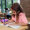 Avril Ogando, 9, works on homework at the Cleghorn Youth Center Afterschool Program on Wednesday, September 6, 2017. SENTINEL & ENTERPRISE / Ashley Green