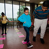 Alynette Diaz, 8, and Yarizmine Melendez, 8, with the help of Edmanuel Encarnacion, 12, play 'math Lava' during the Cleghorn Youth Center Afterschool Program on Wednesday, September 6, 2017. SENTINEL & ENTERPRISE / Ashley Green