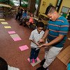 Alex Ledesma-Bajana, 6, counts on his fingers with the help of Edmanuel Encarnacion, 12, during a game of 'math Lava' at the Cleghorn Youth Center Afterschool Program on Wednesday, September 6, 2017. SENTINEL & ENTERPRISE / Ashley Green