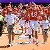Will Spiers (48) of Clemson runs down the hill along side his father and assistant coach Bill Spiers (left) before the Troy game Saturday afternoon.