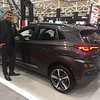 Hyundai product specialisr Mark Laffrey with a 2018 Kona crossver. David S. Glasier, The News-Herald