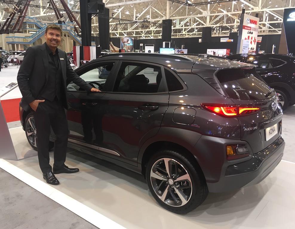 . Hyundai product specialisr Mark Laffrey with a 2018 Kona crossver. David S. Glasier, The News-Herald