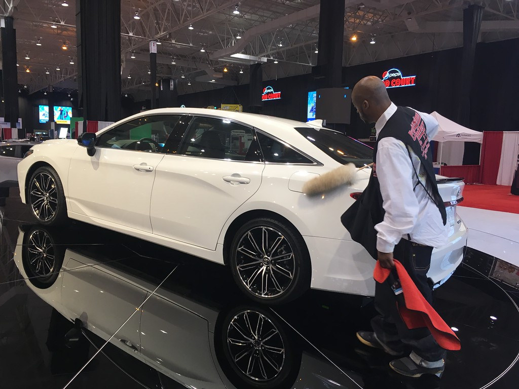 . Cleveland Auto Show attendant does final prep work on a 2019 Toyota Avalon. David S. Glasier, The News-Herald