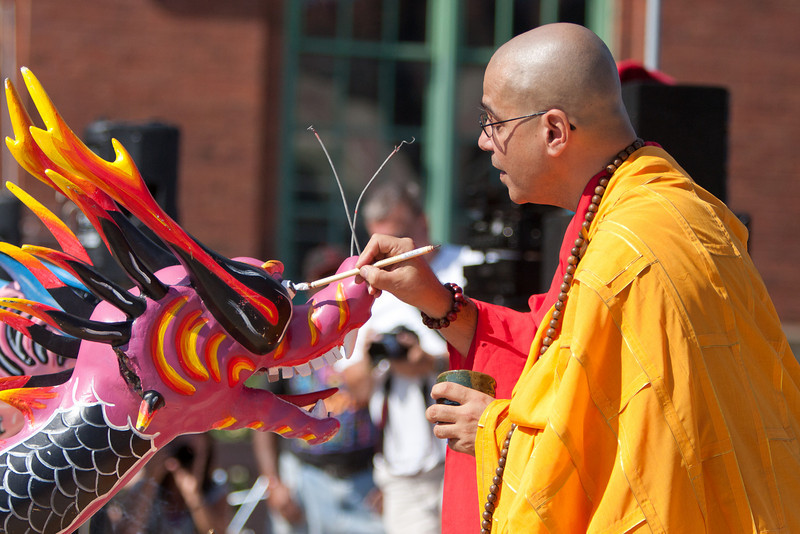 ShihYing-Fa, an abbot from Cleveland's Zen Center, wakes up the dragons by painting their eyes.