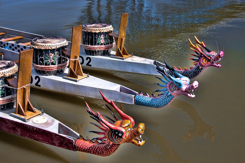 "Dragon boat races are traditionally held as part of the annual Duanwu Festival or Duen Ng observance in China. 19th century European observers of the racing ritual, not understanding the significance of Duen Ng, referred to the spectacle as a ""dragon boat festival"". This is the term that has become known in the West.  Here are the three dragon heads used for the Dragon Boat races in the flats."