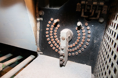 Looking from port, after end door to cage. This is the port motor field power-sharing rheostat / resistor tap switch.
