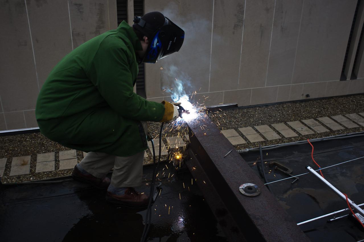 Welding in preparation for installing EME beam.