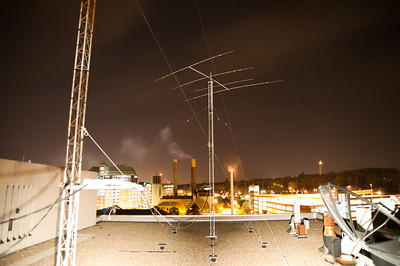 Facing Van Horn Field at night, one of our HF beams and both towers are visible.