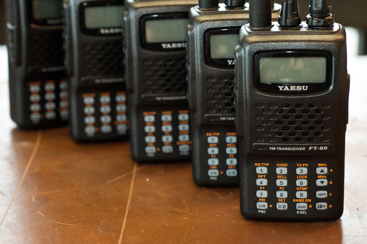 "Our handhelds, out for loan, donated by CAA! The backs are laser-engraved, ""W8EDU""."