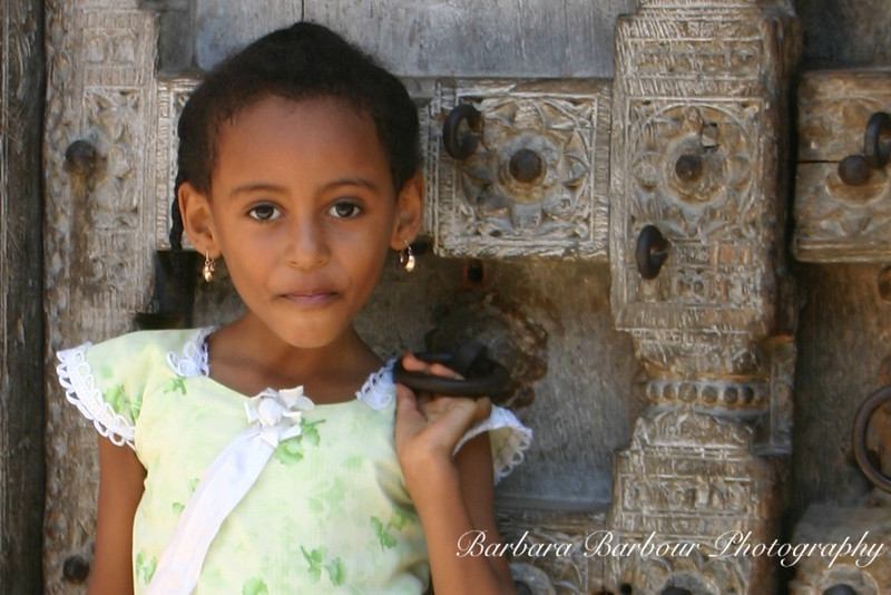 Young girl in doorway, Zanzibar