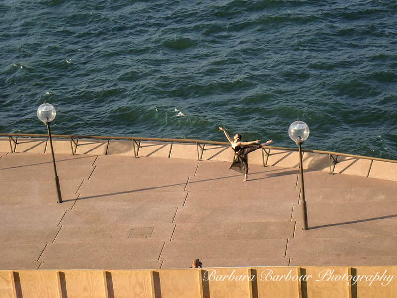 Dancer at opera house walkway