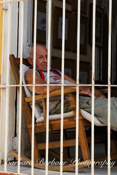 Man in Window in Trinidad