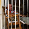Man in Window in Trinidad
