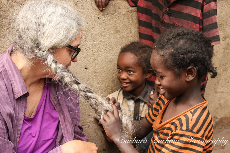 American woman with Ethiopian children of Ari tribe