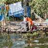Washing clothes in backwaters
