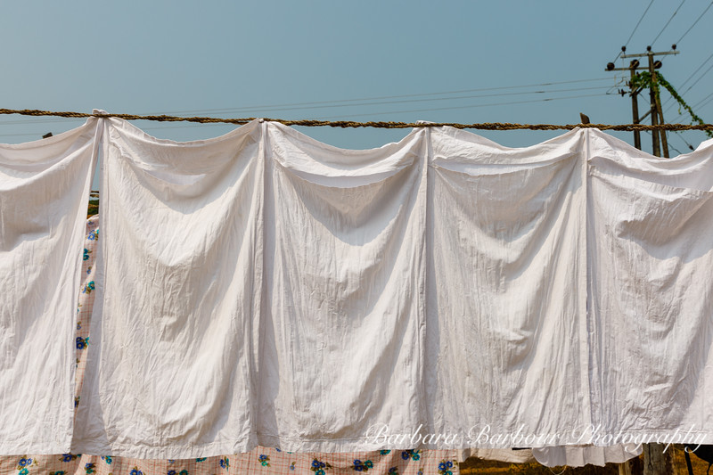 Sheets drying on line