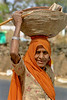 woman with basket, India
