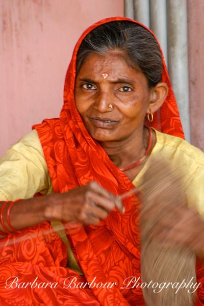 Women making rugs, India