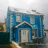 Blue cottage in the rain