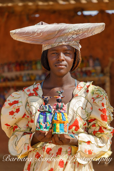 Herero Woman with hand made dolls