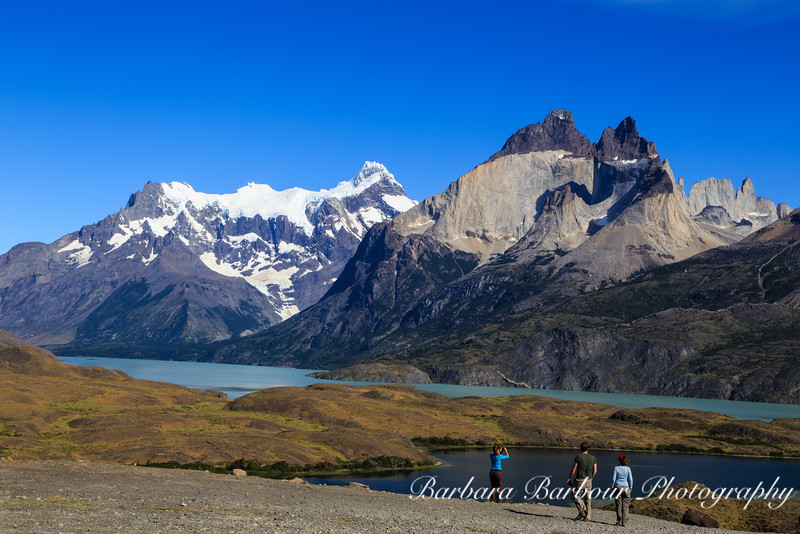 Tourist taking pictures of view at Torres del Paine National Park in Chile