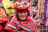 Woman in traditional clothing in Andes Mountains in Peru