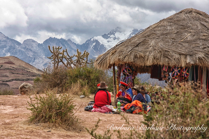 Selling textiles in Andes Mountains, Peru