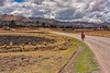 woman walking in Andes mountain road, Peru
