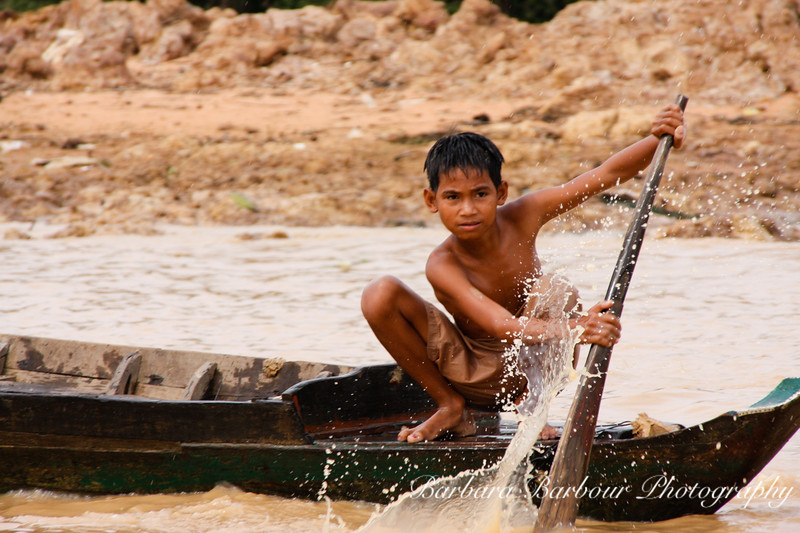 Boy in boat at Tonie Sap floating village,  Cambodia