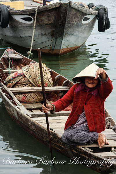 Woman in boat, Hoi An