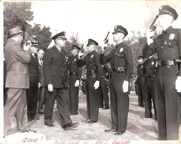 Chief Bill Parker inspects new LAPD graduating class - 1958