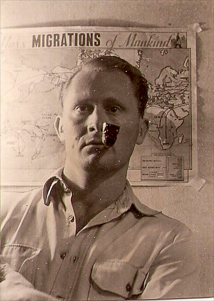 Dad with pipe in front of map-1.jpg