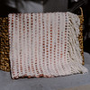 Textured Ivory Blanket with Pink Undertones