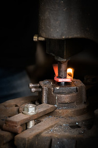 After heating, the press is used to puncture the metal .