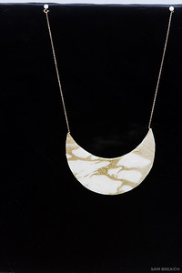 This is the shot of the necklace I used for her to sit on. This was shot on black velvet in natural light.