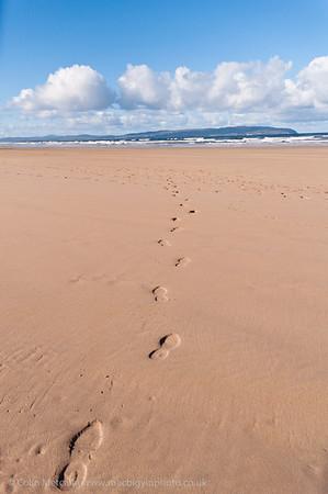 Footprints crossing Castlerock Beach.