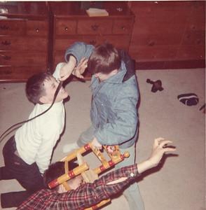 Jim taming lions Mike and Bill January 1966 San Mateo, California