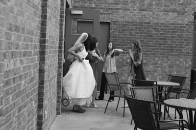 Bride sneaking in the venue just before she is to walk down the isle.