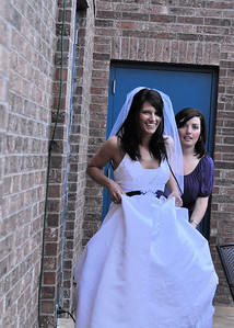 Bride and Her Matron of Honor Sneaking in the Backdoor of the Venue