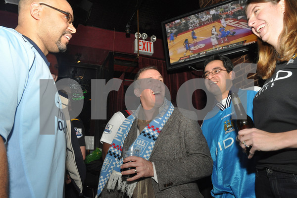 Garry Cook (2nd from left), Manchester City CEO chats with members of the New York City Manchester City Supporters Club at The Mad Hater Saloon in New York.<br /> Thuesday Jan. 21, 2010<br /> Thursday January 21, 2010.<br /> Photo credit: James Higgins