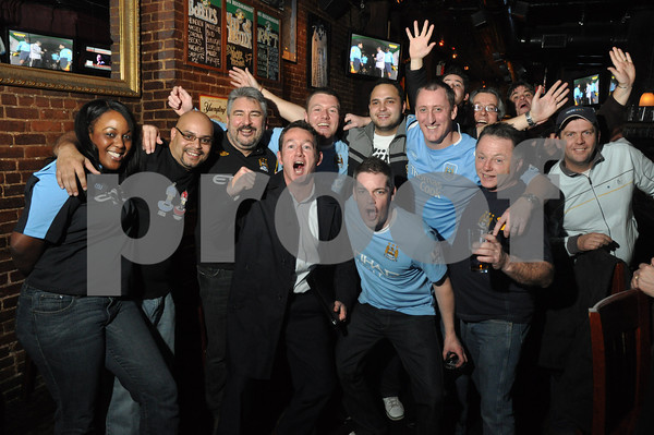 Members of the New York Manchester City Supporters Club gather at The Mad Hatter Saloon on Manhattan's East Side for the City V United Carling Cup first leg.<br /> Tuesday January 19, 2010.<br /> Photo credit: James Higins