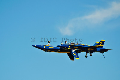 """Blue Angels Lead solo and opposing solo pass each other in carrier landing config and presenting a """"mirror image"""" effect"""