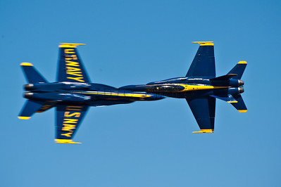 US Navy Blue Angels. Lead solo and opposing solo pass by each other (Knife-edge pass)