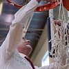 Shelbyville coach David Schmitt cuts down the net after his team's win in the Class 2A Region III championship game.