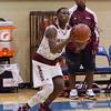 Dacorian Bryan (30) shoots a 3-pointer in the Class 2A Region III Semifinals at Leon High School.