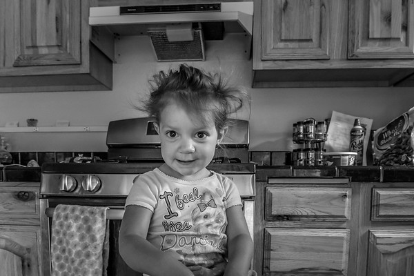 Portrait of a young girl in her home's kitchen.