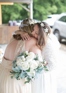 Bride and Bridesmaid Hug, Wedding at Nolichucky Vineyard by Everbright Photography
